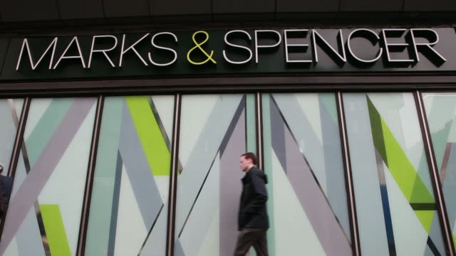 Customers enter and exit a Marks Spencer retail store operated by Marks Spencer Group Plc in London UK on Monday April 7 Various general views...