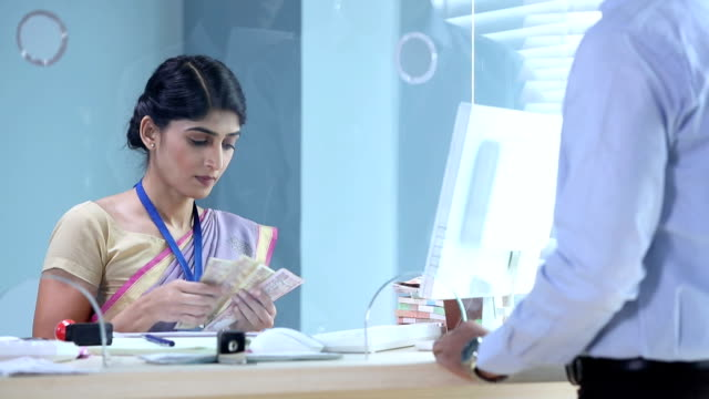 Customers exchanging indian two thousand banknote in bank, Delhi, India