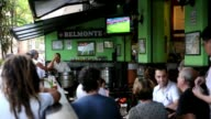 Customers in a bar watch the London 2012 Olympic Games football match between Brazil and Egypt on TV in Rio de Janeiro Brazil on July 26 2012 Rio de...