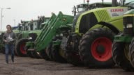 Customers inspect tractors before they are put up for sale at the Cheffins Cambridge Machinery Sales monthly machinery and plant auction in Sutton UK...