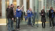 Customers lined up outside Apple store on 5th Avenue in NYC waiting for doors to open to purchase the latest iPad / Apple employees counting down for...