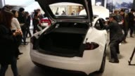 A customers look at a Tesla Motors Inc Model S 90D electric vehicle at the company's showroom in Hanam Gyeonggi Province South Korea on Wednesday...