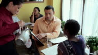 Customers looking at menu in restaurant