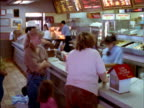 T/L MS Customers ordering food in line at McDonald's counter / Reno, Nevada, USA