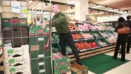 Customers push shopping carts as they shop for goods inside a Tesco supermarket operated by Tesco Plc in London UK on Monday April 20 2015 SHOTS...