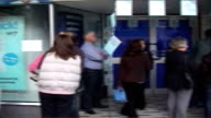 London EXT Shoppers queuing outside Boots store for antiageing face cream 'Protect and Perfect'