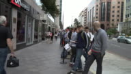 Customers waiting in line to buy the new Apple iPhone 6 and iPhone 6 Plus