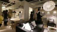 Customers walk through the living room furniture section of the first Ikea store in Tokyo Japan on Thursday April 10 2014