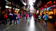 Customers wander in the famous Chenghuang Miao Old Street,Shanghai, China