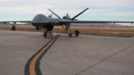 A US Customs and Border Protection Predator drone is prepared for takeoff at the flight operations center at Fort Huachuca in Sierra Vista Arizona...