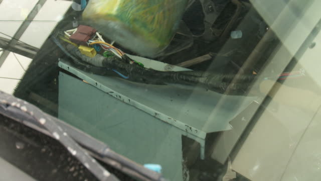 / Customs Border Protection officers confiscate illegal drugs found in vehicle crossing border / removing drugs from car / loading drugs on cart /...