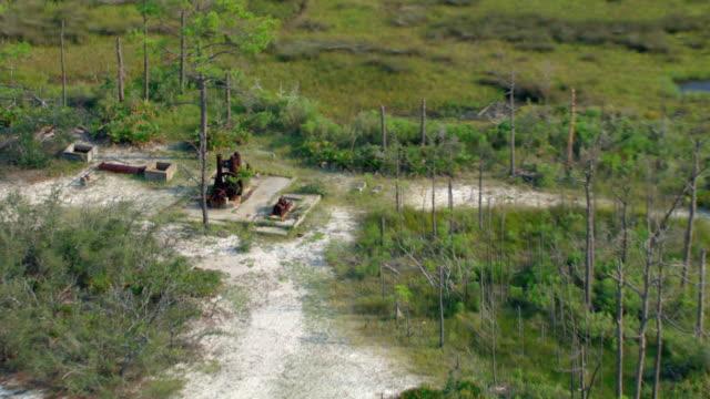 Cut-down trees surround ruins in Gulf Islands National Seashore.