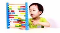 Cute Asian child do arithmetic