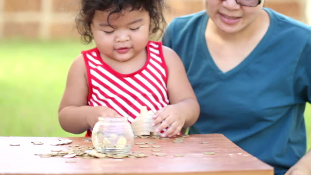 Cute boy with mother learn to count money