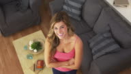 Cute Caucasian woman standing in living room