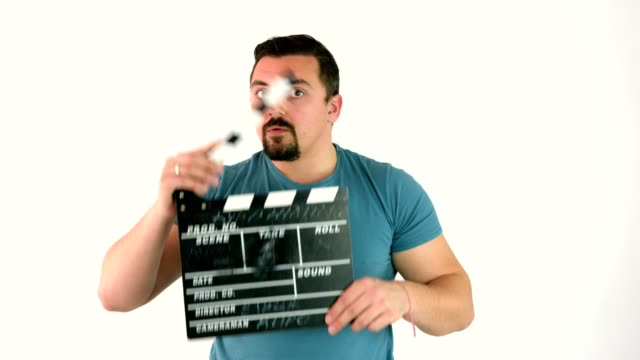 Cute funny guy using or clapping movie film clapperboard or film slate
