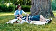 Cute girlfriend feed boyfriend with cherry