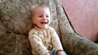 Cute laughing child watching cartoons