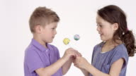 cute little boy (five-years-old) and his sister with cake pops