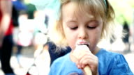 Cute Little Girl Eating Ice Cream Cone