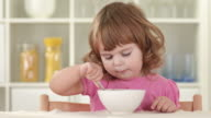 HD: Cute Little Girl Finishing Her Meal