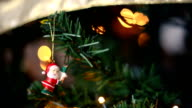 Cute Santa clauss ornament hanging from the Christmas tree