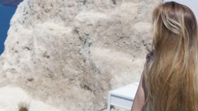 Cute woman & wellbeing in Santorini
