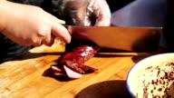 Cuting sausage