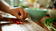 Cutting Chilies on a Cutting Board for Nasi Goreng