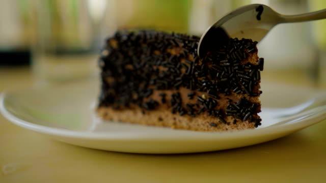 Cutting chocolate cake