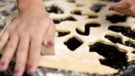 cutting cookies with pastry cutter