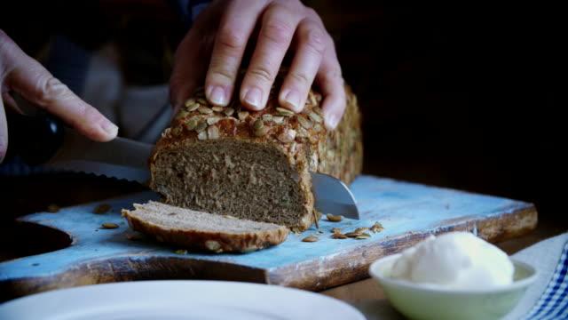 Cutting Fresh Homemade Brown Bread
