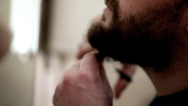 Cutting his beard
