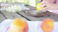Cutting orange to add juice to apple and pear mixture