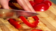 Cutting red paprika