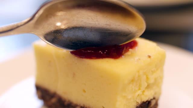 Cutting strawberry Cheesecake