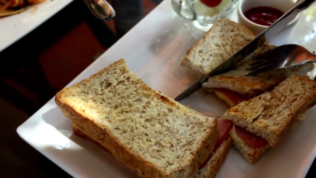 cutting  toast sandwich