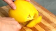 Cutting yellow bell paprika