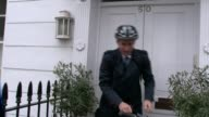 NHS Cyber attack / Jeremy Hunt doorstep ENGLAND London PHOTOGRAPHY *** Jeremy Hunt from house and away on bicycle ignoring reporter's questions about...