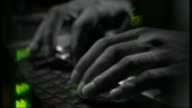 Viruses stolen from America's National Security Agency R05120705 / 5122007 Hands typing on a computer keyboard / man sat typing at computer /...