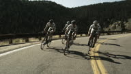 cycling team riding downhill in unison