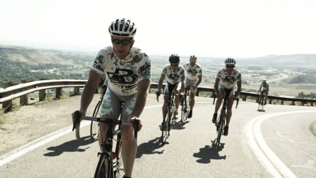 cycling team riding uphill