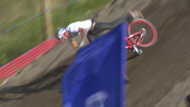 MS BMX cyclist jumping from ramp and crashing / lying on ground / USA