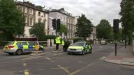 Cyclist killed after a collision with a van in North London ENGLAND London EXT Police vehicles on cordoned off road Police officers and police cars...