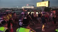 Cyclists are encircled by police prior to arrest after an attempt to delay the Olympic Games by blocking the Bow Flyover London 2012 Opening Ceremony...