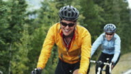 cyclists climbing uphill