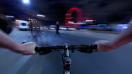 A cyclists POV nighttime journey travelling rapidly from Westminster along the Thames embankment towards the City of London