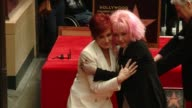 Cyndi Lauper and Sharon Osbourne at Hollywood Walk Of Fame on April 11 2016 in Hollywood California