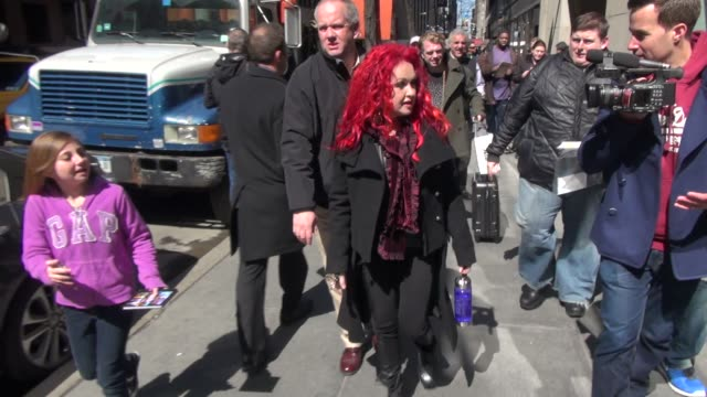 Cyndi Lauper exits the Today show in Rockefeller Center while walking to her car stops to sign for a young fan in Celebrity Sightings in New York