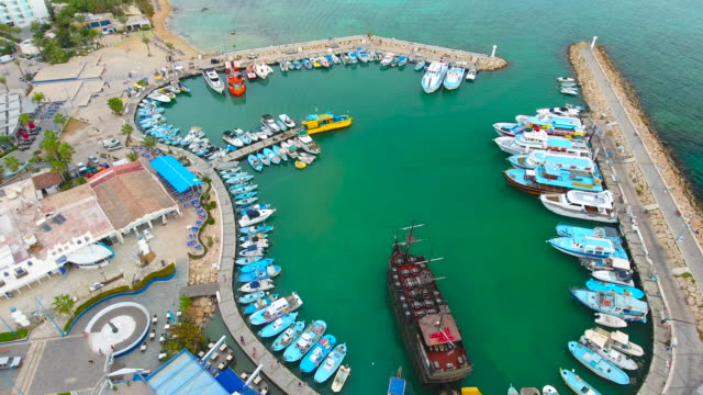 Cyprus, Ayia Napa. Aerial View. Ships in the harbor. Beautiful landscape and sea waves